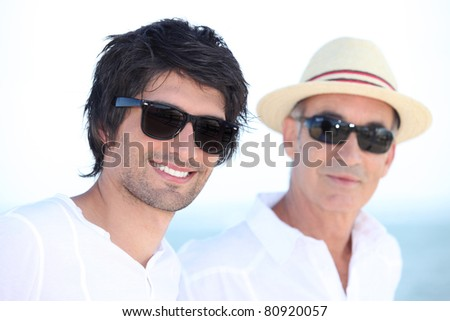 Man with his father in the sunshine - stock photo