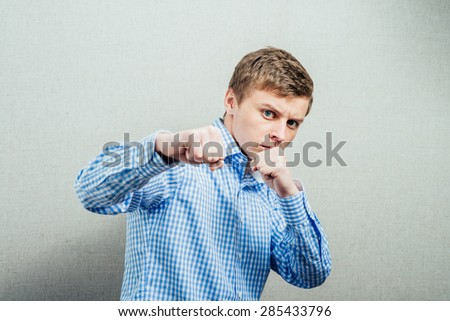 man with his fists - stock photo