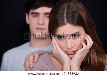 Man with his hand on a woman's shoulder