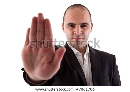man with his hand raised in signal to stop - stock photo