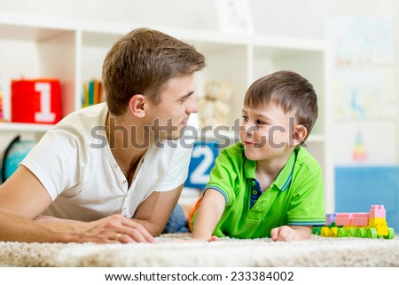 man with his kid son playing together - stock photo