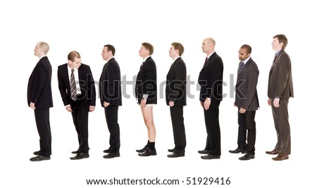 Man with his pants down standing in a line - stock photo