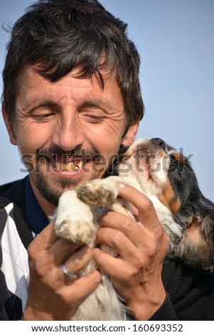 man with his pet dog - stock photo