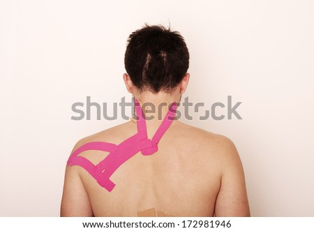 Man with kinesio taping tape on his back - stock photo