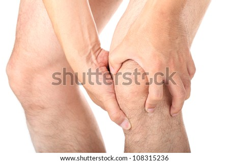 Man with knee pain on white background - stock photo
