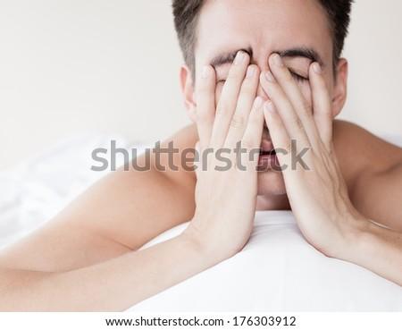 Man with lack of sleep - stock photo