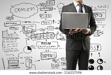 man with laptop against business strategy - stock photo