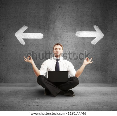 man with laptop meditation, concept of choice - stock photo