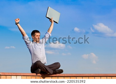 man with laptop outdoor celebrate the victory  - stock photo