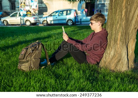man with laptop outdoors - stock photo