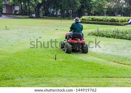 man with lawn mower - stock photo