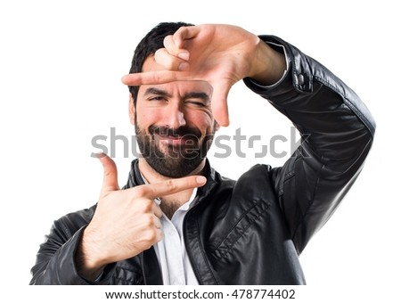 Man with leather jacket focusing with his fingers