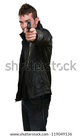 man with leather jacket pointing with gun against a white background