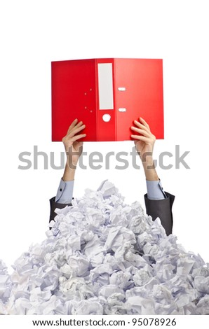 Man with lots of crumpled paper - stock photo