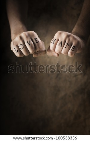 Man with Love and Hate (fake) tattoos.