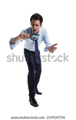 Man with magnifying glass in hand   - stock photo