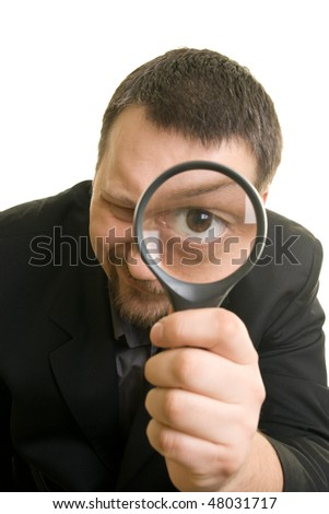 Man with Magnifying Glass searching - stock photo