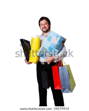 Man with many bags from shopping - stock photo