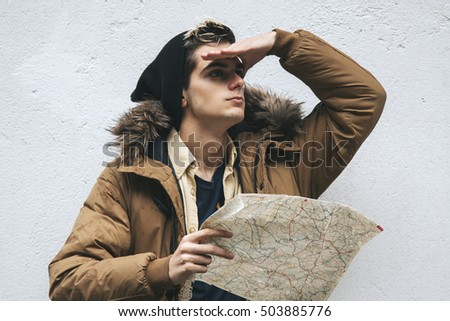 man with map and binoculars on white background outdoors