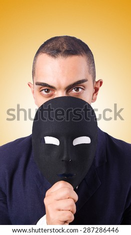 Man with mask against the gradient - stock photo
