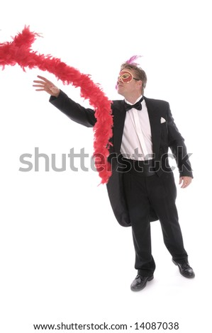 man with mask, feather boa and bow tie - stock photo