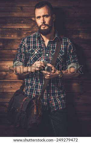 Man with messenger bag and camera  - stock photo