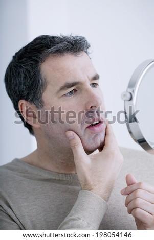 Man with mirror - stock photo