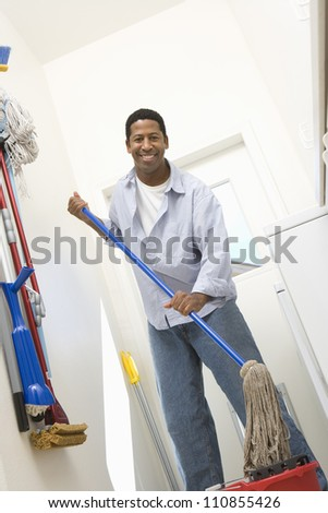Man With Mop Cleaning House - stock photo