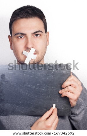 man with mouth covered - stock photo