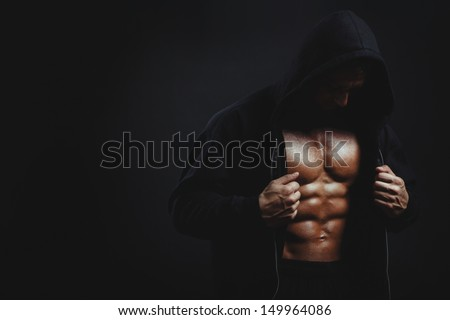 Man with muscular torso - stock photo