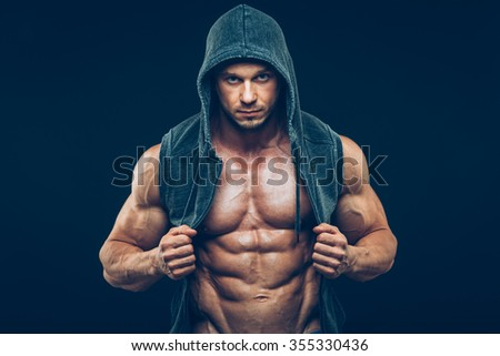 Man with muscular torso. Strong Athletic Man Fitness Model Torso showing six pack abs - stock photo