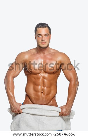 Man with naked musculartorso posing in studio - stock photo