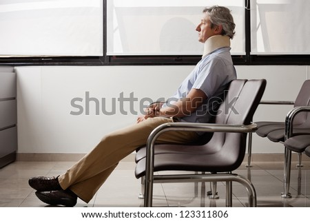 Man With Neck Injury Waiting In Lobby - stock photo
