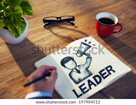 Man with Note Pad and Leadership Concepts - stock photo