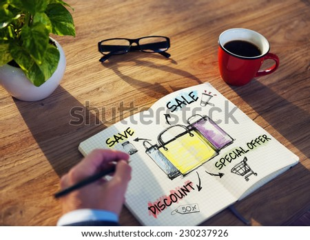 Man with Note Pad and Sale Concept - stock photo