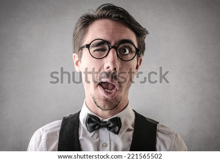 Man with one eye closed  - stock photo