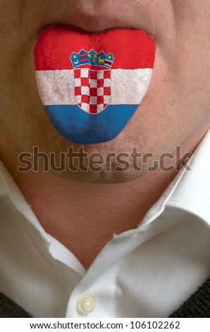 man with open mouth spreading tongue colored in croatia flag as symbol of values like teaching, learning, multilingual speaking of different languages - stock photo