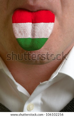 man with open mouth spreading tongue colored in hungary flag as symbol of values like teaching, learning, multilingual speaking of different languages - stock photo