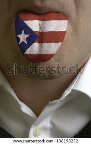 man with open mouth spreading tongue colored in puerto rico flag as symbol of values like teaching, learning, multilingual speaking of different languages - stock photo
