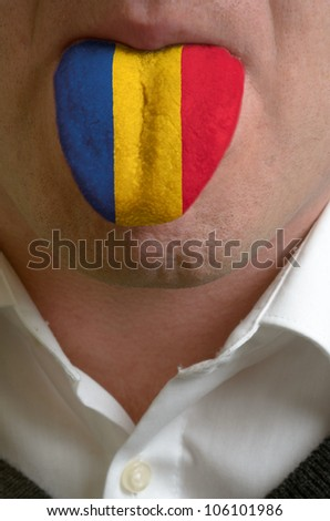 man with open mouth spreading tongue colored in romania flag as symbol of values like teaching, learning, multilingual speaking of different languages - stock photo