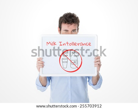 man with painful expression after drinking milk - stock photo