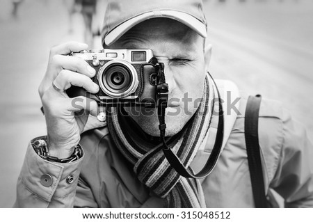 Man with photo camera portrait