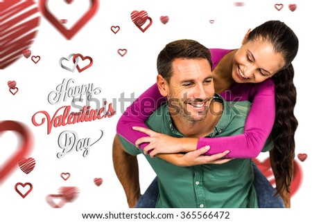 Man with piggy back to his girlfriend against cute valentines message - stock photo