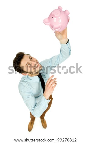 Man with piggy bank - stock photo