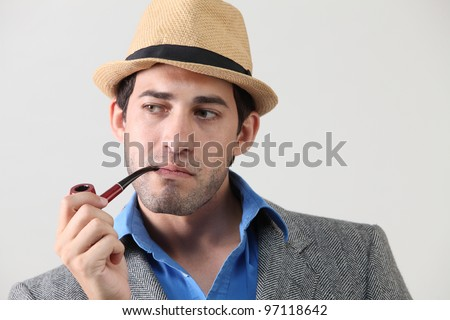 Man with pipe in mouth - stock photo