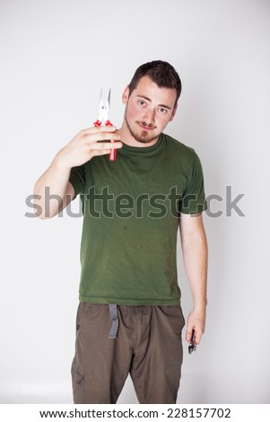 man with pliers on a white background - stock photo