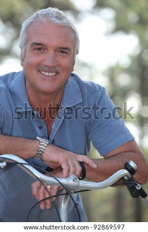Man with push bike