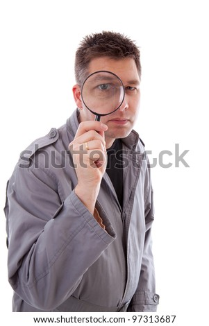 Man with raincoat is looking through magnifying glass and has a big eye over white background
