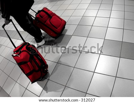 Man with red bags at the airport - stock photo