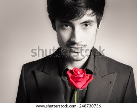 Man with red rose - stock photo